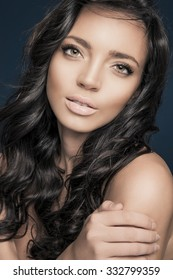 Beautiful model with long hair and bright make up. Pure beauty, Studio shot, vertical