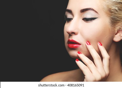 Beautiful model with make-up, red lips and manicure