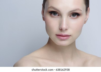 beautiful model with nude makeup healthy skin and blue background