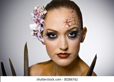 beautiful model with ornament on her face