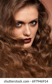 Beautiful model with perfect make up and hairstyle in studio photo. Beauty and fashion. Hairstyle and make up