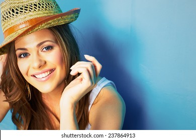 beautiful model portrait on blue background . young modern style woman close up face .
