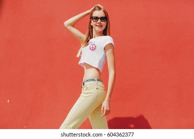 beautiful model pose for a photo in trendy clothes