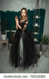 Beautiful model is posing in long black dress