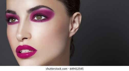 beautiful model with purple makeup, closeup beauty portrait