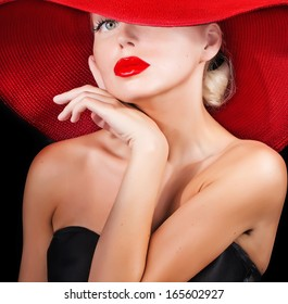 beautiful model  in red hat with red lips looking at camera