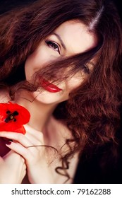 Beautiful model with red sexy lips and long hair