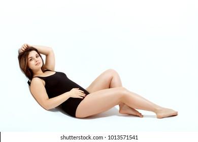 Beautiful model size plus in a black swimsuit.