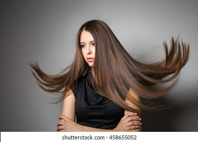 Beautiful model with smooth flying hair