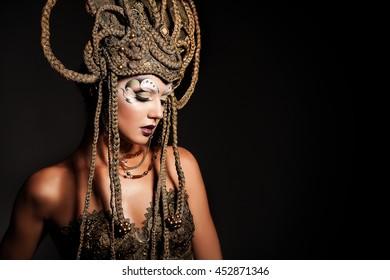 Beautiful model with trendy makeup and original handmade crown. Body Art.