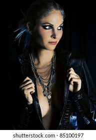 Beautiful model wearing a leather jacket, necklace, and dramatic makeup