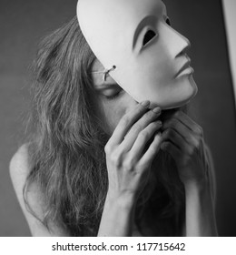 a beautiful model with white mask -  volto bianco. studio shot with daylight.