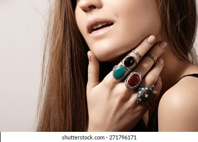 Beautiful model woman with clean skin, perfect hair, natural fashion makeup. Luxurious style with awesome chic jewellery, vintage ring. Romantic boho accessory