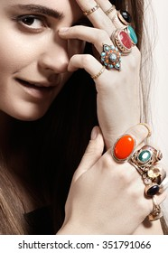 Beautiful model woman with clean skin, perfect hair, natural fashion makeup. Luxurious style with awesome chic jewellery, vintage ring. Romantic boho accessory. Bright vintage rings