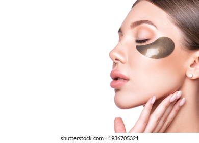 Beautiful model woman with collagen and hydrogel eye patch.
