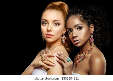Beautiful models girls with set of Jewelry. Luxury girls in shine jewellry: Eearrings, Necklace, and Ring. Women in jewelry from Gold, Precious Stones, Siamonds. Beauty and accessories