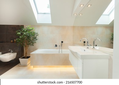 Beautiful modern bathroom with big illuminated bathtube