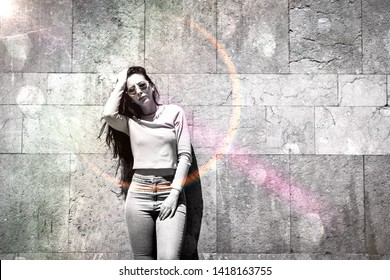 beautiful modern bright black and white with light effects urban photo of young brunette female fashion skinny model posing outside on sunny spring day in front of wall with copy space