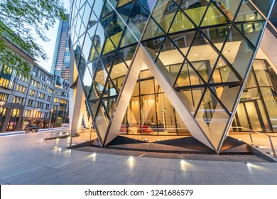 Beautiful modern buildings of the City at night, London. Business and corporate concept.