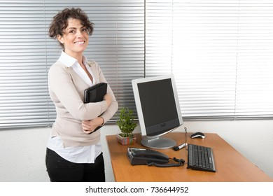 beautiful modern businesswoman holding tablet computer in office building