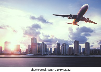 Beautiful modern city view with sunlight and flying by airplane. Travel concept