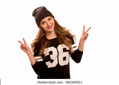 The beautiful modern city young woman wearing a black sports sweatshirt and the connected black hat. The fashionable girl on the isolated white background. Horizontal, average retouch.