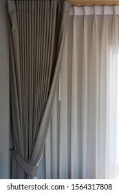 Beautiful modern fabric brown curtain with lighting window interior decoration contemporary