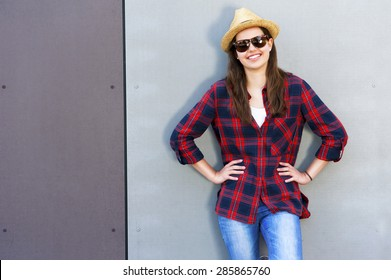 Beautiful modern girl near the wall. Youth style. Fashion shot.