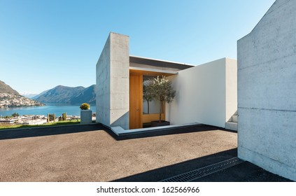beautiful modern house in cement, outdoor, entry view