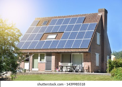 A beautiful modern house love the ideas to build a save energy house by solar Panel on the roof. background and copy space.