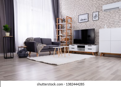 Beautiful Modern Living Room With Empty Gray Sofa