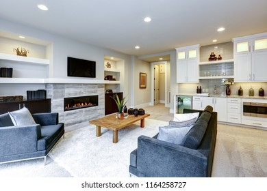 Beautiful modern living room interior with stone wall and firepl
