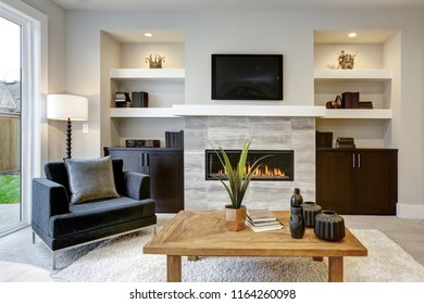 Beautiful modern living room interior with stone wall and fireplace in luxury home