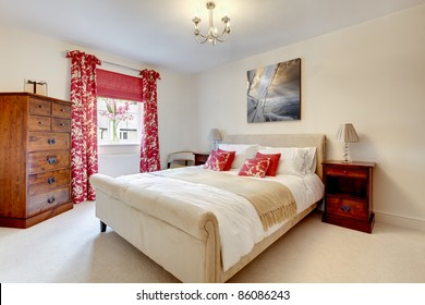 Beautiful modern luxury bedroom with brightly colored fabrics containing bed, chest of drawers and side tables with lamps. Picture above bed by same contributor -  Shutterstock ID: 78107380
