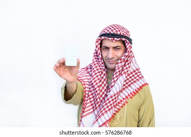 beautiful modern muslim business  young man portrait show cadit card on white background