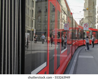 Beautiful modern red tram running on rails