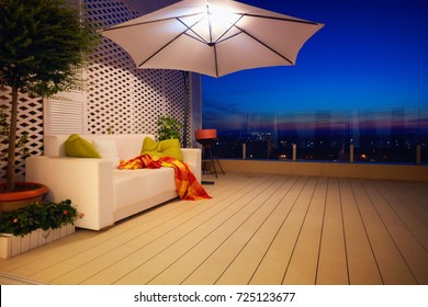 beautiful modern rooftop patio, terrace with evening city view
