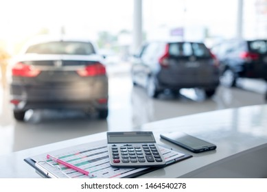 Beautiful modern showrooms with cars that sell background as new cars in stock blur for the four-wheeled tire industry, set at a large warehouse.
