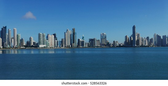 The beautiful and modern skyline of tall city buildings of Downtown Panama under a blue sky