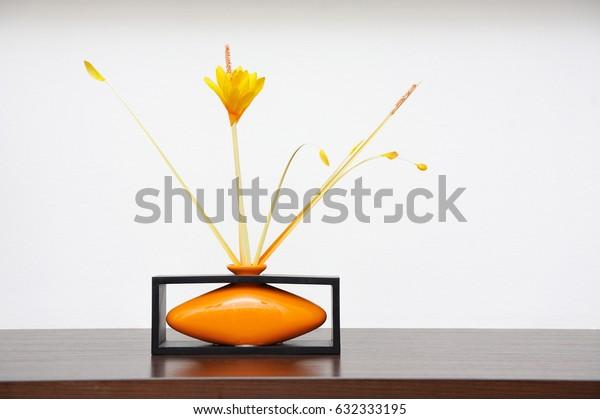 Beautiful and modern vase on the shelf