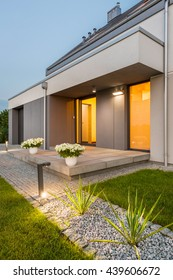 Beautiful modern villa with backyard and decorative outdoor lighting, external view