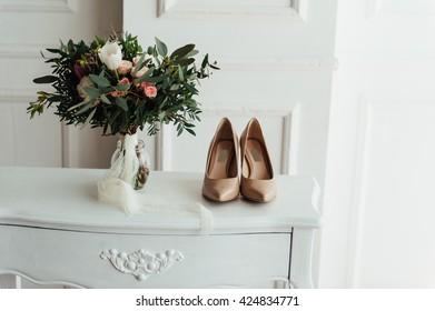 beautiful modern wedding bouquet on wooden planks.