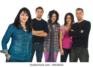 Beautiful modern woman in denim clothes smiling in front of image and her friends standing together in background