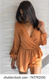 Beautiful modern woman, fall fashion romper