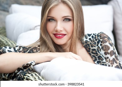 Beautiful modern woman with long hair. Smiling girl