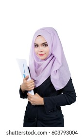 Beautiful modern Young Asian Muslim business woman holding reports,isolated on white background.
