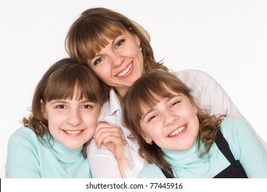 beautiful mom and daughters on a white background