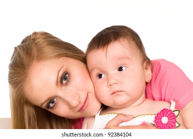 beautiful mom with her baby on a white background