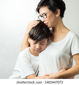 A beautiful moment of a preteen boy and his mom. Forgiveness, Mom's heart, Greatest love, Understanding, Protecting, Parenting teens, Beloved son, Single mom, Togetherness, concept.