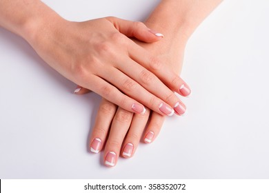 Beautiful moon french manicure. Woman's manicure on a white background.